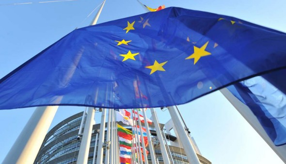 European flags fly in front of the Europ